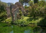"""This picture shows a view of the Garden of Ninfa on May 18, 2013 near Cisterna di Latina. Rare plants, enchanting ruins and the tinkle of waterfalls: the English-style botanical oasis of Ninfa near Rome is a rare idyll that is widely referred to as """"the world's most romantic garden"""". AFP PHOTO / LAURENT KALFALA"""